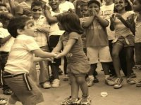 children dancing in front of other children