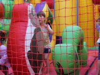 girl in an inflatable castle