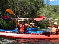 Kayak riders lifting the paddles