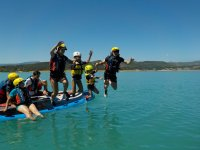 Jump into the water from the Big SUP board