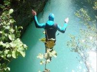 Jumping into the pool of the ravine
