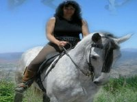 through the field on horseback