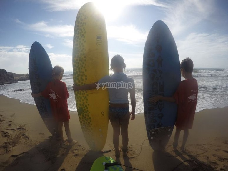 Three kids with the paddle surf