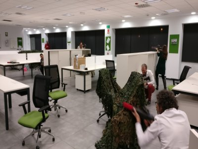 激光打击在你的办公室团队建设马德里2小时