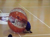 boy getting into a plastic bubble