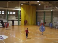 boys playing bubble football