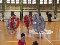 playing bubble football in a closed pavilion