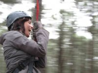girl pulling a zip line