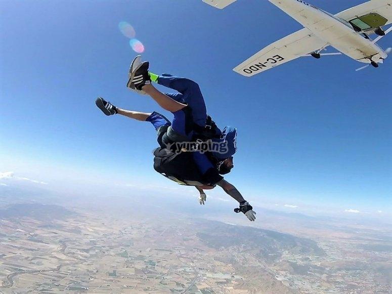 Parachute instructor descending