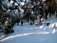 Walking with snowshoes through Penalara