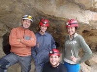 Group with helmet at the entrance of the cave