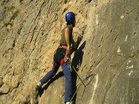 boy climbing a natural vertical wall