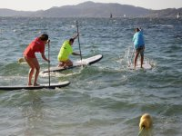 practicing sup in the sea