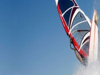 catching a wave while windsurfing