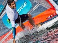 man playing the sea windsurfing