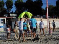 learning paddle surf in the sand