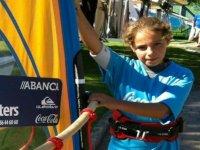 nina taking a board windsurfing