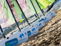 windsurfing equipment in the sand