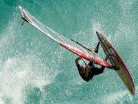 man practicing windsurfing