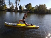 Stretching on the paddle surf board