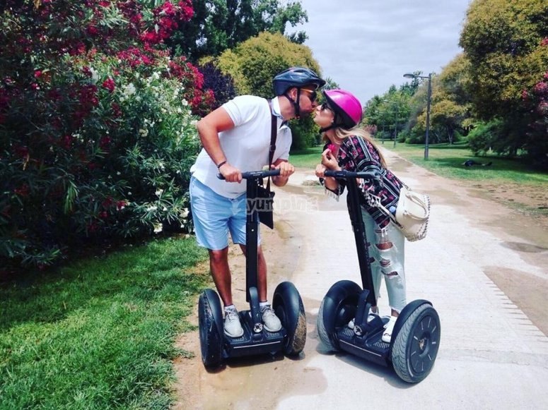 Kissing each other from their segways