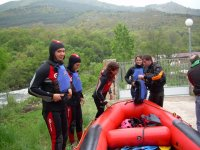 Putting on wetsuits for descent