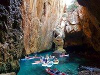 Paddle surf guided tour through Cueva de Los Peces