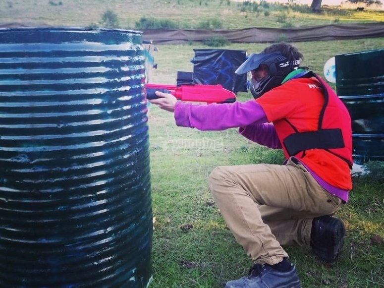 Soft paintball shooting behind the barricade