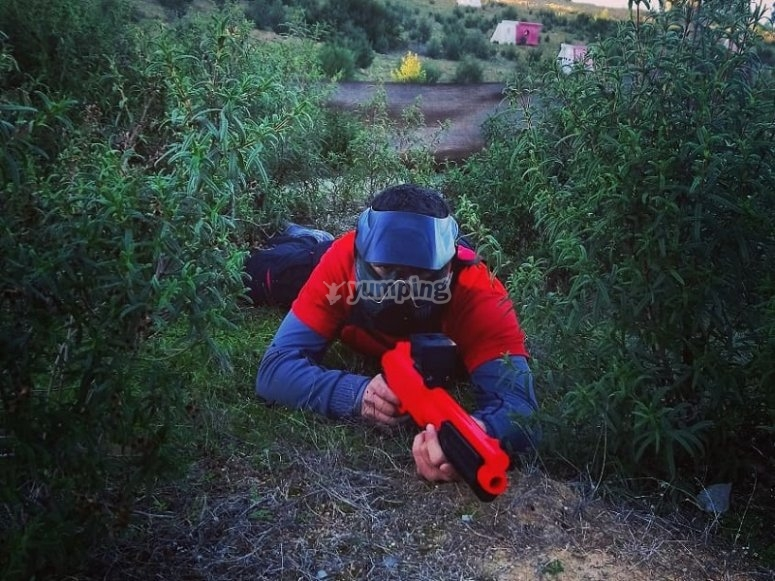 Soft paintball player in the ground