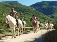 Horseback riding along the Salarsa Valley