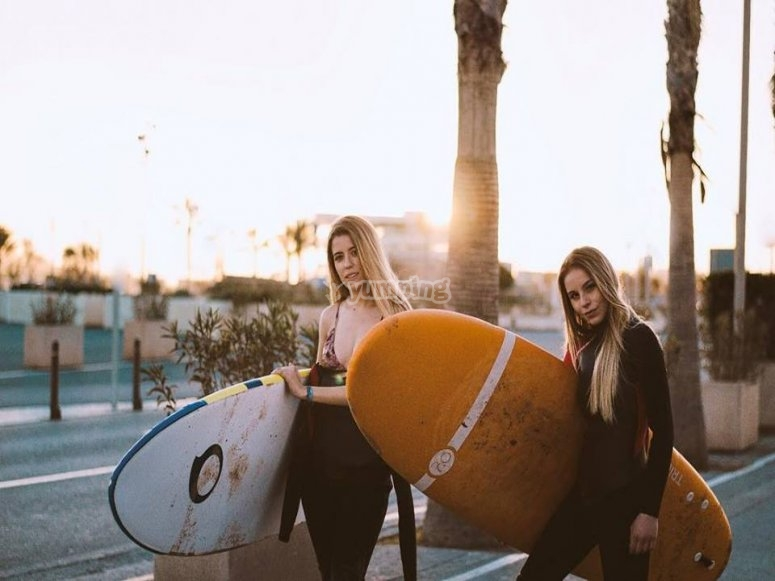 Girls with surfboards in Valencia