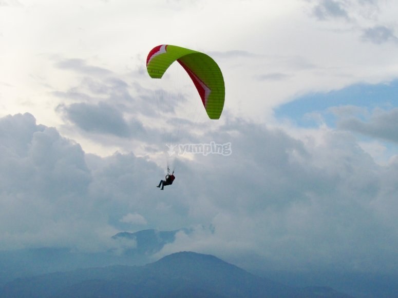 Paraglide under the clouds