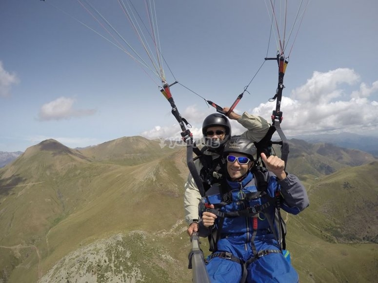 Professional pilot flying by a paraglide