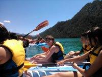 Young people having fun on board the kayaks