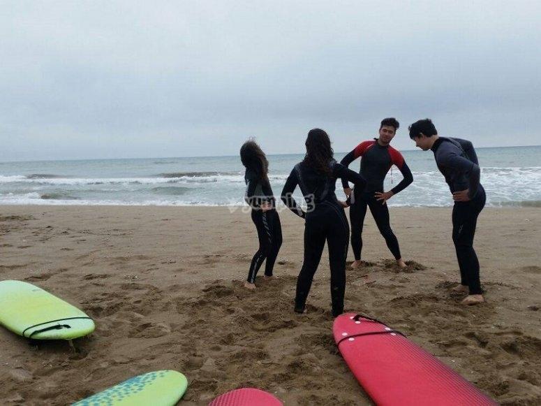 Surfing class in Les Botigues beach