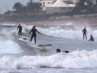 Catching waves with surf boards in Castelldefels