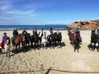A caballo en la playa en Formentera