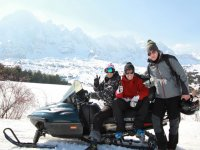 Friends with the snowmobile