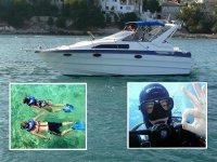 Operatore subacqueo vicino allo yacht
