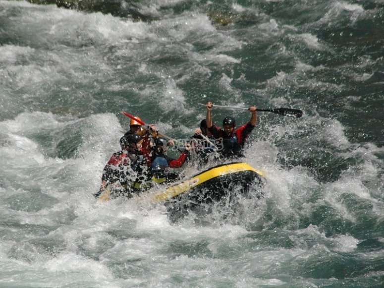 Rafting in the rough waters of Esera´s