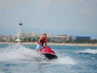 Riding a jet ski in Roses