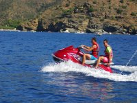 Two guys jet skiing