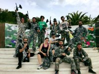 Paintball team with mimetized monkeys