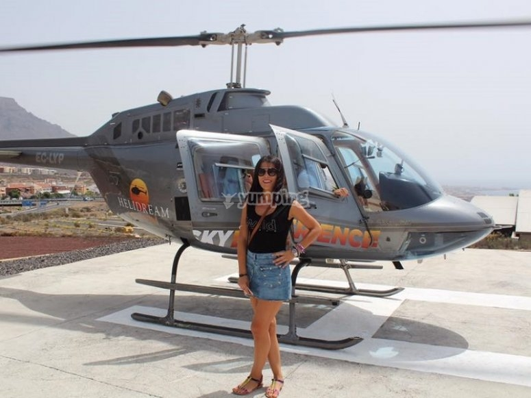 Next to the helicopter in the heliport