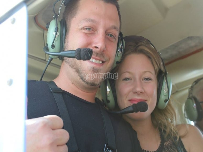 Couple flying in a helicopter