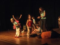 children singing and dancing on a stage