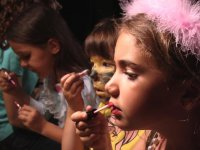 children painting their faces