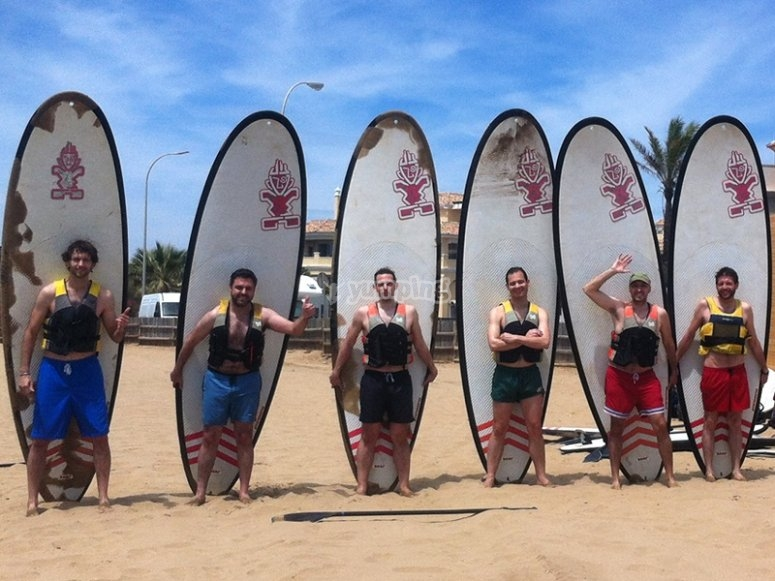 Boys on the paddle surf board