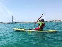 On knees on the SUP surfboard in Torrevieja