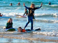 Surfing students playing